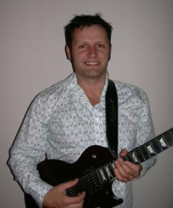 Paul Vojnovic: Guitarist in Ain't Behavin'